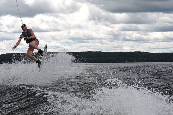 Camper on a wakeboard at Arrowhead Camp