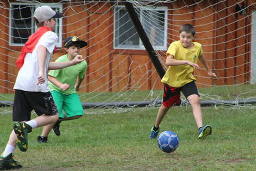 Campers playing soccer on the field at Arrowhead Camp