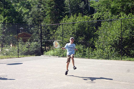 Camper playing tennis at Arrowhead Camp