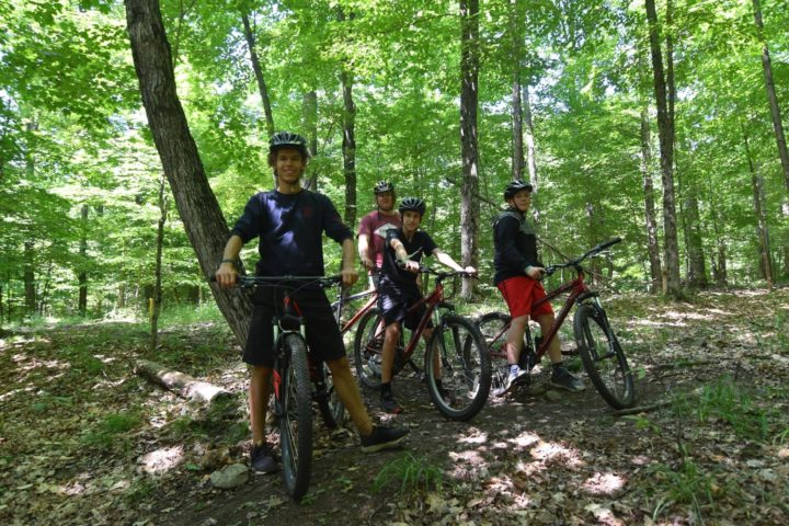 A group of campers out mountain biking at Arrowhead Camp
