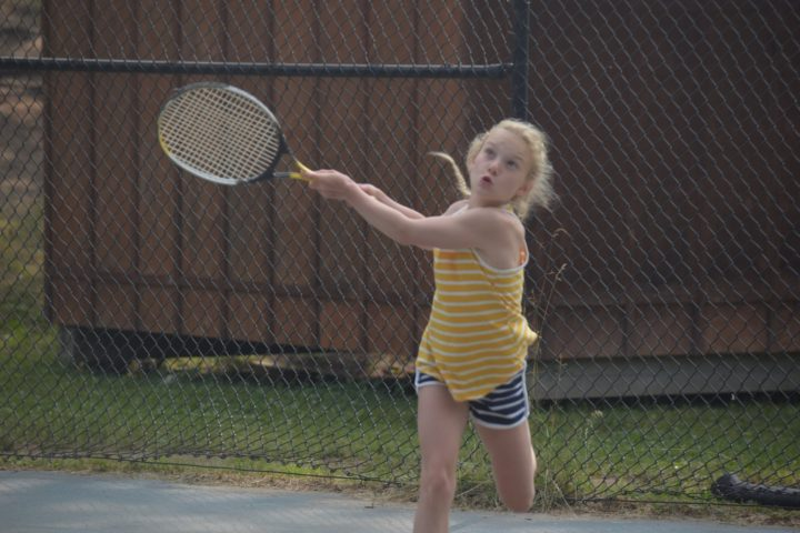 Girl camper playing tennis at Arrowhead Camp.
