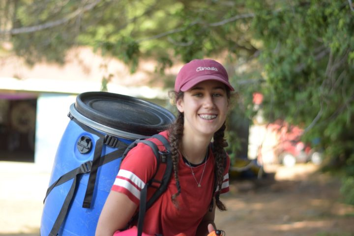 LIT Camper carrying a food barrel at Arrowhead Camp canoe trip.