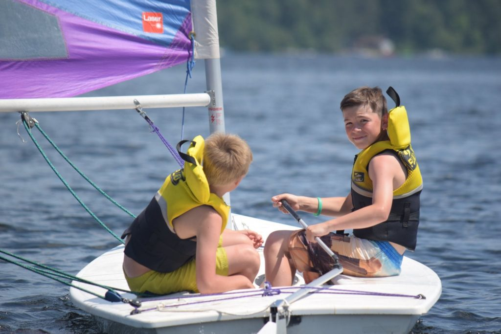 Two campers going sailing at Arrowhead Camp.