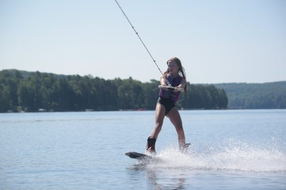 Girl camper going Wakeboarding at Arrowhead Camp.